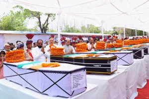 The Union Home Minister, Shri Rajnath Singh paying tributes to the martyred CRPF personnel, in Raipur, Chhattisgarh on April 25, 2017. The Chief Minister of Chhattisgarh, Dr. Raman Singh and the Minister of State for Home Affairs, Shri Hansraj Gangaram Ahir are also seen.