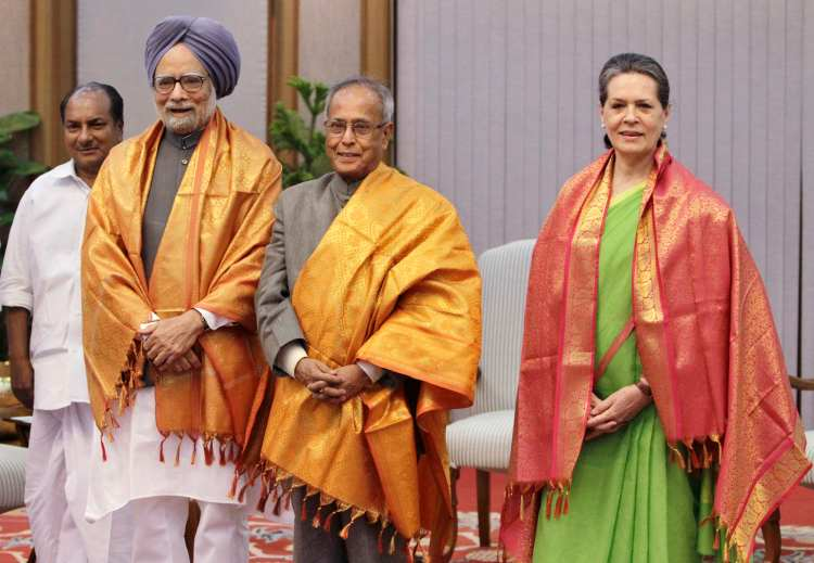 Indian Prime Minister Manmohan Singh (2nd L), Chief of India's ruling Congress party Sonia Gandhi (R) and India's Finance Minister Pranab Mukherjee (C) pose for pictures as India's Defence Minister A.K. Antony (L) watches after the United Progressive Alliance (UPA) meeting in New Delhi June 15, 2012. The ruling UPA named Finance Minister Pranab Mukherjee as its nominee for president after a week of political turmoil that exposed the fragility of the coalition government as it struggles to contain an economic crisis. REUTERS/B Mathur (INDIA)