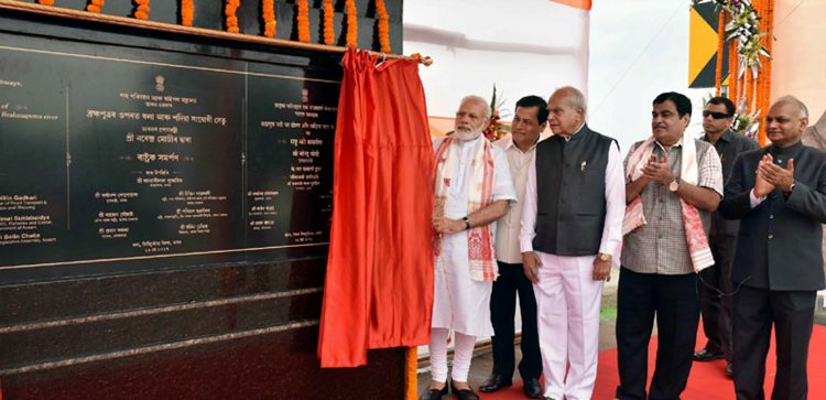 Sadia: Prime Minister Narendra Modi unveiling the plaque to mark the dedication to the nation of the Dhola-Sadia Bridge, across River Brahmaputra, in Assam on Friday. Assam Governor Banwarilal Purohit, the Union Minister for Road Transport & Highways and Shipping Nitin Gadkari and the Chief Minister of Assam Sarbananda Sonowal are also seen. PTI Photo (PTI5_26_2017_000164B)