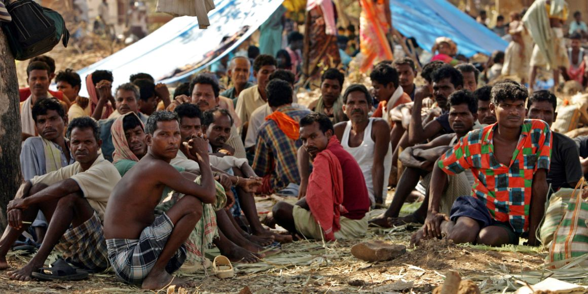 Indian tribal people sit at a relief camp in Dharbaguda in Chhattisgarh. File Photo Reuters