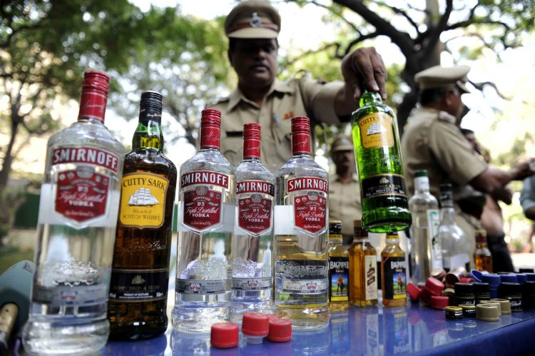 An officer checks the siezed liquor worth 96,780 by excise department and arrested two person in Mumbai on Wenesday - Salman Ansari.DNA