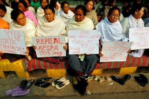 Women hold placards during a protest against the Armed Forces Special Powers Act (AFSPA) in New Delhi January 25, 2008. Dozens of women from the northeastern Indian state of Manipur protested on Friday against the AFSPA, which gives troops the right to arrest and shoot at suspected rebels. REUTERS/Adnan Abidi (INDIA) - RTR1W9HG