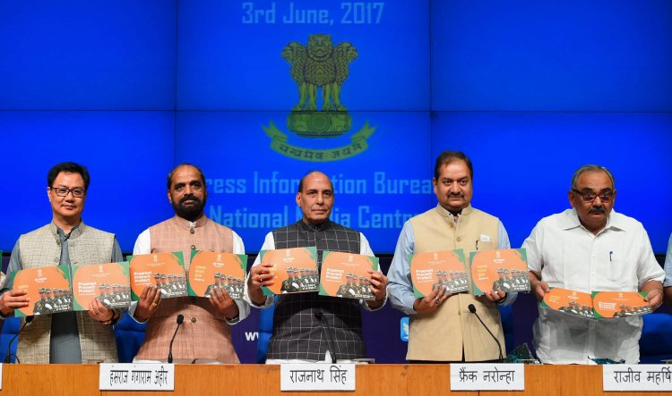 New Delhi: Union Home Minister Rajnath Singh with MoS for Home Affairs Hansraj Ahir and Kiren Rijiju releasing a booklet at a press conference to announce the three years achievements of NDA, in New Delhi on Saturday. PTI Photo by Shahbaz Khan(PTI6_3_2017_000055A)