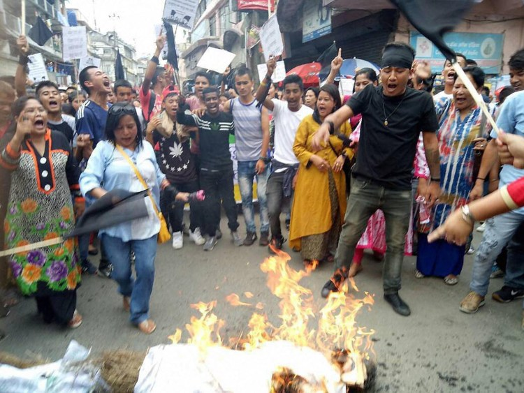 Darjeeling : Gorkha Janmukti Morcha (GJM) supporters during their protest in Darjeeling on Thursday. PTI Photo (PTI6_8_2017_000247B)