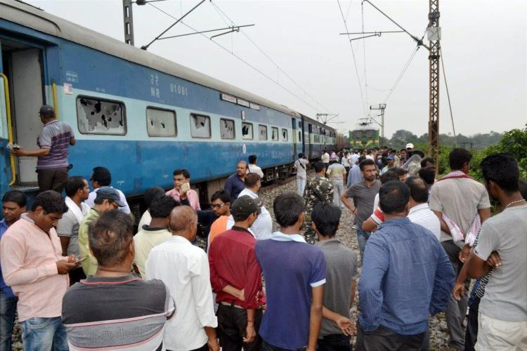 Dhanbad : Protestors vadalise Dhanbad -Alappuzha Express between Nichitpur & Tetulmari station in Dhanbad on Thursday in protest against the decision of Railway Board to close traffic on Dhanbad-Chandrapura rail line from 15th June due to underground fire. PTI Photo (PTI6 15 2017 000192B)