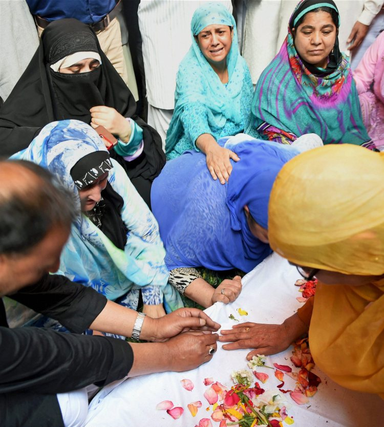 Srinagar: Family members and relatives wail near the coffin of DySP Mohammad Ayoub Pandith at his residence in Srinagar on Friday. Pandith was lynched to death by a mob outside the historic Jamia Masjid in downtown Srinagar in the wee hours on Friday. PTI Photo by S Irfan  (PTI6_23_2017_000141B)