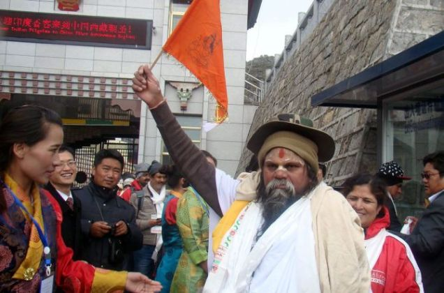 Nathula Pass: The first batch of Kailash-Mansarovar Yatra pilgrims arrive on the Chinese side through the Nathula Pass on Monday. PTI Photo (PTI6_22_2015_000048B) *** Local Caption ***
