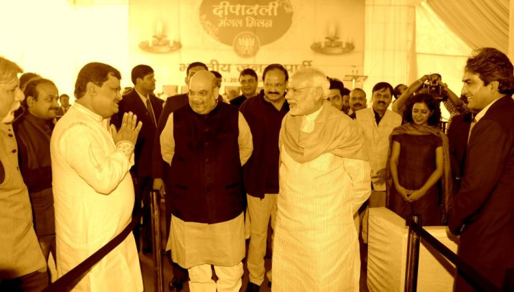 prime minister narendra modi_ bjp president shri amit shah interacting with media personnel at diwali milan program at ashok road on 28 november 2015