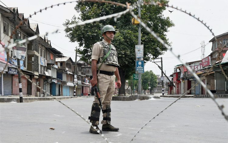 Srinagar: Security jawan stands guard during restrictions in down town Srinagar on Friday. Authorities imposed restrictions in parts of Srinagar as a precautionary measure ahead of slain Hizbul Mujahideen commander Burhan Wani's first death anniversary. PTI Photo by S Irfan (PTI7_7_2017_000129A)