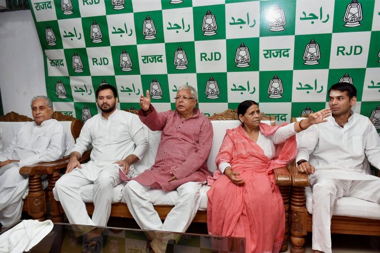 Patna: RJD Chief Lalu Prasad Yadav with senior leader and wife Rabri Devi, Bihar Deputy Chief Minister Tejaswi Yadav and Health Minister Tej Pratap at Legislative party meeting in Patna on Monday. PTI photo(PTI7_10_2017_000017B)