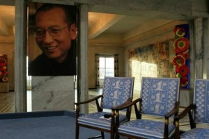 A picture of Nobel Peace Prize laureate jailed Chinese dissident Liu Xiaobo is seen near an empty chair where he would have sat, during the Nobel Peace Prize ceremony at Oslo City Hall December 10, 2010. REUTERS/Heiko Junge/Scanpix Norway/Pool/Files