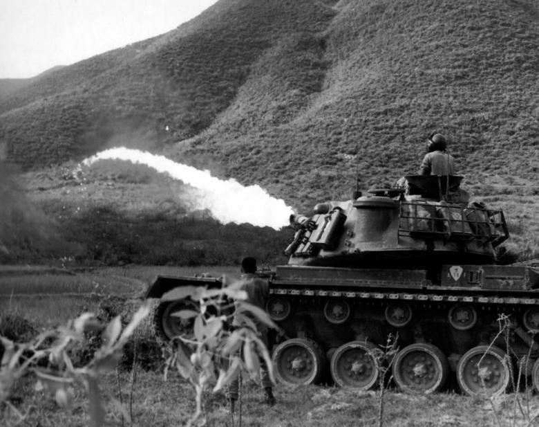 A U.S. Marine tank launches flamethrower in action near Da Nang, Vietnam, 1965. REUTERS/Courtesy U.S. Army