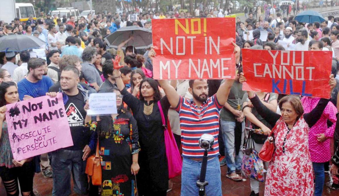 "Mumbai : People participating the silent protest ""Not in My Name"" against the targeted lynching in Mumbai on Wednesday. PTI Photo (PTI6_28_2017_000223A)"