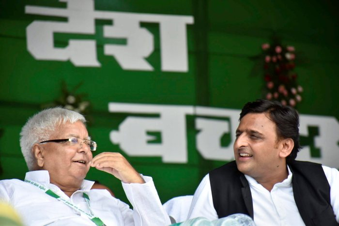 Patna: (L-R)  Rashtriya Janata Dal (RJD) chief Lalu Prasad Yadav with former Uttar Pradesh CM Akhilesh Yadav during the  'BJP bhagao, desh bachao' rally at Gandhi Maidan in Patna on Sunday. PTI Photo(PTI8_27_2017_000084A) *** Local Caption ***