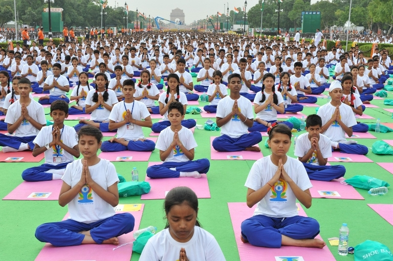 Students performing Yoga Photo by Narendramodi.in