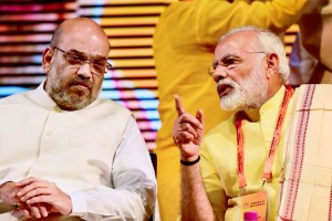 New Delhi: Prime Minister Narendra Modi talks with BJP President Amit Shah at partys national executive meeting at Talkatora stadium, in New Delhi on Monday. PTI Photo by Kamal Kishore (PTI9 25 2017 000046B)