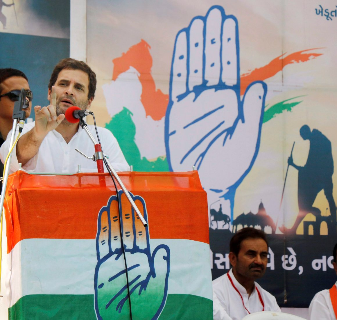 Vadodara: Congress vice-president Rahul Gandhi addresses a public meeting during his road show at Karjan village in Vadodara on Tuesday. PTI Photo (PTI10_10_2017_000070B)