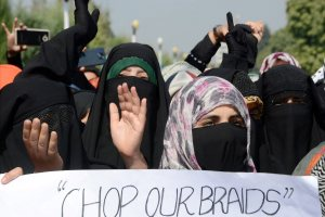 Srinagar: Students shout slogans during a protest rally against the fresh incidents of braid chopping in the Valley, at Kashmir University in Srinagar on Thursday. PTI Photo  (PTI10_12_2017_000150B)