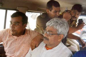 Ghaziabad: Former BBC journalist Vinod Verma being arrested by Chhattisgarh Police from his Ghaziabad residence on Friday morning over charges of blackmail and extortion, in Ghaziabad on Friday. PTI Photo  (PTI10_27_2017_000197B)