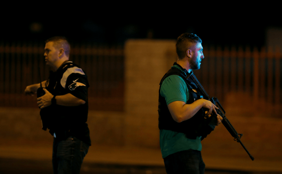 Las Vegas Metro Police officers work near the concert venue after a mass shooting at a music festival on the Las Vegas Strip in Las Vegas, Nevada, U.S. October 1, 2017. REUTERS/Las Vegas Sun/Steve Marcus