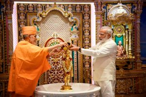 Gandhinagar:Prime Minister Narendra Modi along with Mahant Swami Maharaj offer puja at Akshardham on the occasion of Akshardham silver jubilee celebration in Gandhinagar, Gujarat on Thursday. PTI Photo/Twitter(PTI11_2_2017_000211A)