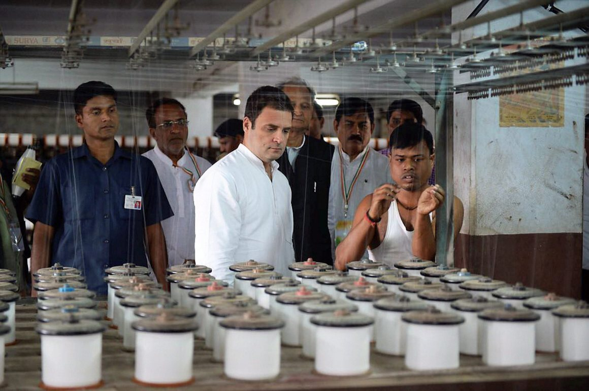 Surat: Congress vice-president Rahul Gandhi during his visit to a textiles factory in Surat on Wednesday. PTI Photo (PTI11_8_2017_000211B)