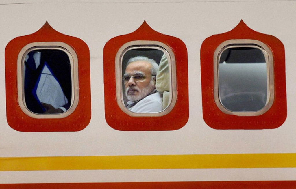 Narendra Modi on his special aircraft as he arrives at Brasilia International Airport in Brazil in 2015. Photograph: PTI