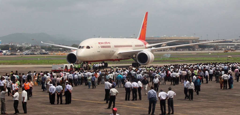 FILE PHOTO:::: New Delhi: Air India employees gather around a newly acquired Air India B-787 Dreamliner aircraft after it landed at the airport in Mumbai in Sept. 2012. Foreign airlines can now own up to 49 per cent stake in national carrier Air India, with the Cabinet clearing a proposal in this regard on Wednesday, Jan. 10, 2018. PTI Photo by Shirish Shete (PTI1_10_2018_000056B)