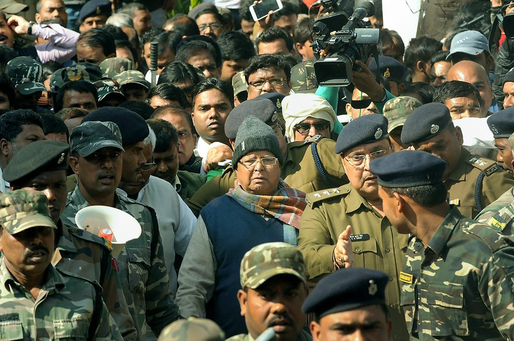 Ranchi: Bihar's former chief minister Lalu Yadav being produced at the special CBI court to receive his quantum of sentence in a fodder scam case, in Ranchi on Wednesday. PTI Photo(PTI1_3_2018_000043B)
