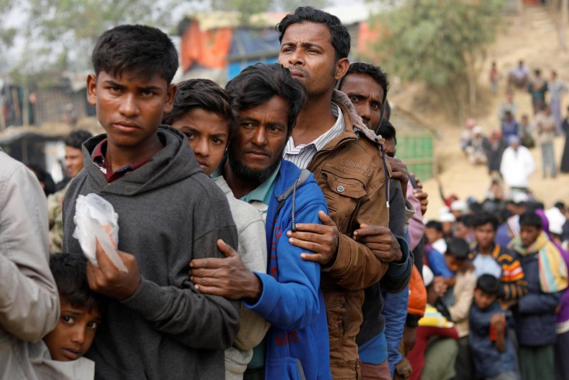 Rohingya refugees line up for daily essentials distribution at Balukhali camp, near Cox's Bazar, Bangladesh January 15, 2018. REUTERS/Tyrone Siu