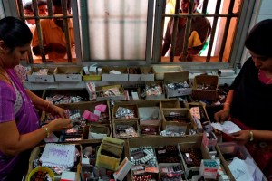 Pharmacists dispense free medication, provided by the government, to patients at Rajiv Gandhi Government General Hospital (RGGGH) in Chennai July 12, 2012. Chennai is the capital of Tamil Nadu, one of two Indian states offering free medicine for all. The state provides a glimpse of the hurdles India faces as it embarks on a programme to extend free drug coverage nationwide. Picture taken July 12, 2012. To match Analysis INDIA-DRUGS/             REUTERS/Babu (INDIA - Tags: SOCIETY DRUGS HEALTH) - RTR357H6