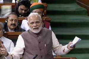New Delhi: Prime Minister Narendra Modi speaks in the Lok Sabha, at the parliament in New Delhi on Wednesday. PTI Photo / TV Grab (PTI2_7_2018_000095B)