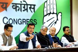 New Delhi: AICC spokesperson Randeep Singh Surjewala with party leaders Sushilkumar Shinde, Ashok Gehlot and Gaurav Gogoi addressing the media at AICC headquarters, in New Delhi on Monday. PTI Photo by Arun Sharma (PTI12_18_2017_000187B) *** Local Caption ***