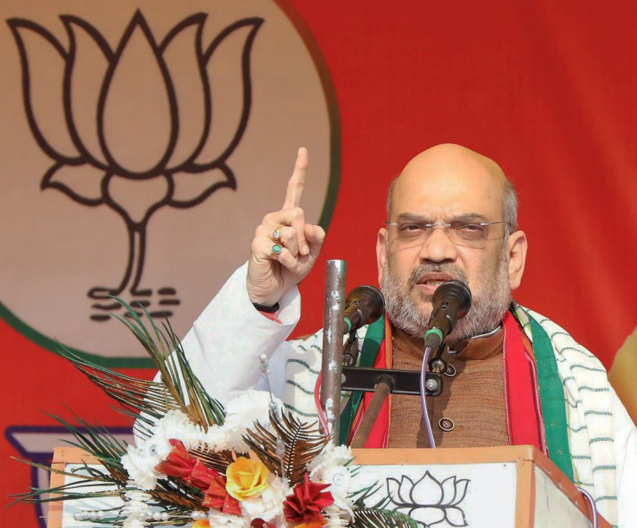 Chawmanu: BJP National President Amit Shah addresses a public meeting in Chawmanu, Tripura on Sunday. PTI Photo (PTI2_11_2018_000188B)