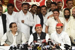 Lucknow: Samajwadi Party president Akhilesh Yadav with senior leaders Kiranmoy Nanda and Azam Khan addresses a press conference after the by-election results, at the party headquarters in Lucknow on Wednesday. PTI Photo by Nand Kumar (PTI3_14_2018_000160B)