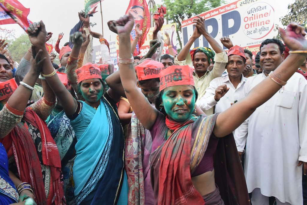 Gorakhpur: Samajwadi Party member celebrate the success of their party in the Lok Sabha bypoll elections, in Gorakhpur on Wednesday. PTI photo(PTI3_14_2018_000153B)