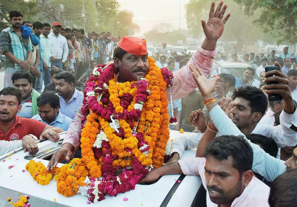 Allahabad: Samajwadi Party candidate Nagendra Pratap Singh Patel celebrate after the results of Phulpur Lok Sabha bypoll election, in Allahabad on Wednesday. PTI Photo (PTI3_14_2018_000154B)