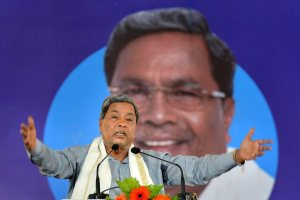 "Pavagada: Karnataka Chief Minister Siddaramaiah speaks during the inauguration of the solar panels at ""Shakti Sthala"", the 2,000 Mega Watt Solar Power Park, in Pavagada Taluk situated about 150 kms from Bengaluru on Thursday. PTI Photo by Shailendra Bhojak (PTI3_1_2018_000178B)"