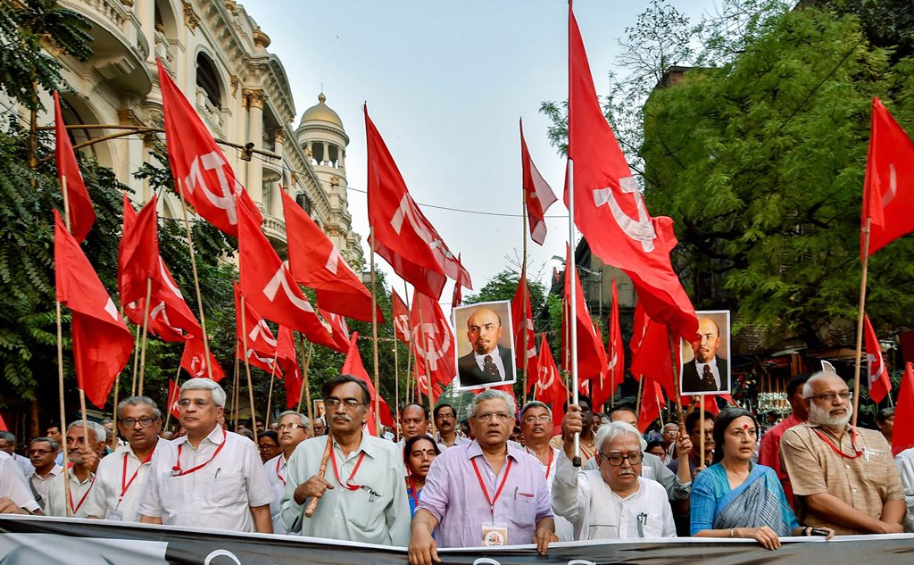 Kolkata: CPI(M) General Secretary Sitaram Yehchuri with other Politburo members Prakash Karat, Suryakanta Mishra, Brinda Karat, Biman Bose and other leaders at a rally in Kolkata on Tuesday to protest against vandalising of Lenin's statue in Tripura. PTI Photo by Swapan Mahapatra (PTI3_6_2018_000158B)