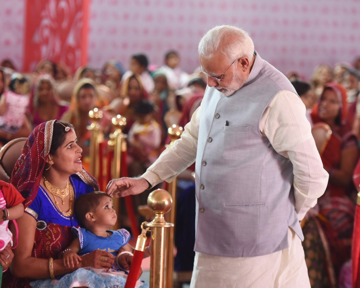 The Prime Minister, Shri Narendra Modi interacting with the Beti Bachao Beti Padhao beneficiaries, in Jhunjhunu, Rajasthan on March 08, 2018.
