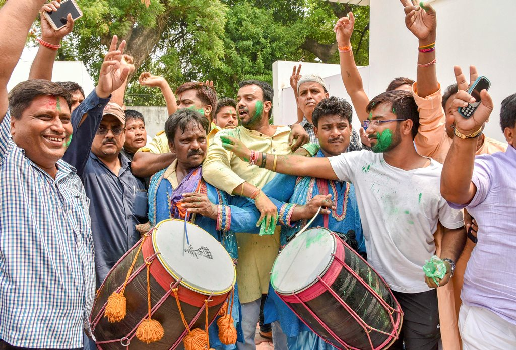 Patna: Rashtriya Janata Dal (RJD) supporters celebrate after their party's victory at Jokihat Assembly by-elections, in Patna on Thursday, May 31, 2018. (PTI Photo) (PTI5_31_2018_000064B)