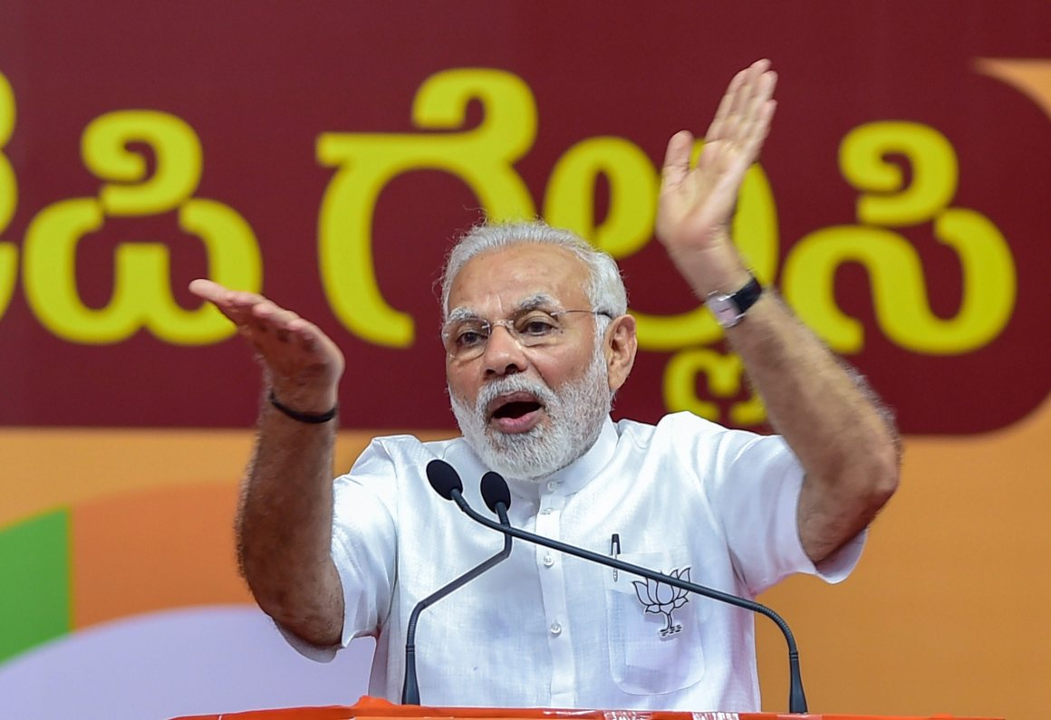 Bengaluru: Prime Minister Narendra Modi addresses a public rally for the Karnataka assembly elections, in Bengaluru on Thursday. PTI Photo by Shailendra Bhojak (PTI5_3_2018_000163B)