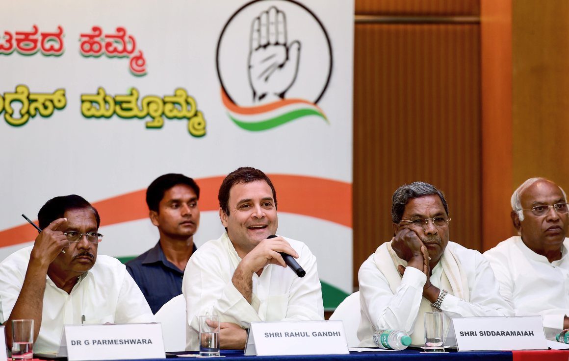 Bengaluru: Congress President Rahul Gandhi with senior party leader Mallikarjun Kharge, Karnataka Chief Minister Siddaramaiah and KPCC President G Parameshwara during a press meet, ahead of the Assembly elections 2018, in Bengaluru on Thursday. PTI Photo by Shailendra Bhojak (PTI5_10_2018_000083B)