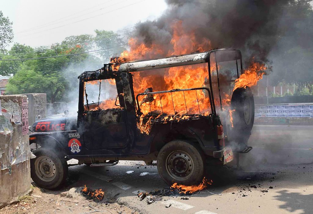 Allahabad: A police jeep in flames after it was torched by the Allahabad Central University students, who were protesting against the 'hostel washout' decision of the administration, in Allahabad on Tuesday, June 05, 2018. (PTI Photo) (PTI6_5_2018_000052B)