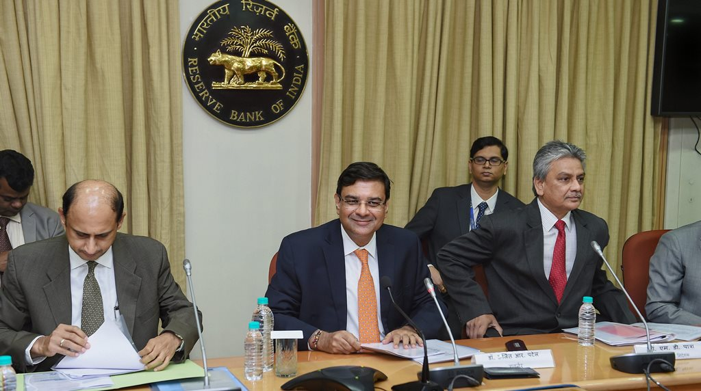 Mumbai: RBI Governor Urjit Patel (C), Deputy Governor Viral Acharya (L) and Executive Director Micheal Patra (R) during the customary post monetary policy review press conference, in Mumbai on Wednesday, June 08, 2018. (PTI Photo/Shirish Shete)(PTI6_6_2018_000105B)