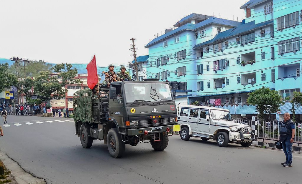 Shillong: Army personnel patrol a street during curfew after clashes between the residents of the city's Punjabi Line area and Khasi drivers of state-run buses, in Shillong on Monday, June 04, 2018. (PTI Photo) (PTI6_4_2018_000172B)