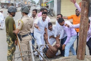 Nanded: A protester is carried away after being injured during a protest rally demanding reservation for Marathis, in Nanded on Tuesday, July 24, 2018. Maratha outfits have called for a bandh in Maharashtra a day after of a protestor demanding reservation for the community jumped off a bridge over Godavari river and died, in Aurangabad. (PTI Photo) (Story no BOM12)(PTI7_24_2018_000217B)