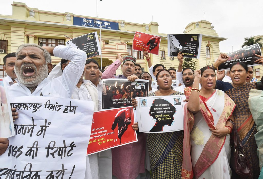 Patna: Rashtriya Janata Dal, Congress and Communist Party of India legislators stage a protest against the Bihar shelter home case during the ongoing Monsoon Session, outside Bihar Assembly in Patna on Tuesday, July 24, 2018. (PTI Photo)(PTI7_24_2018_000026B)