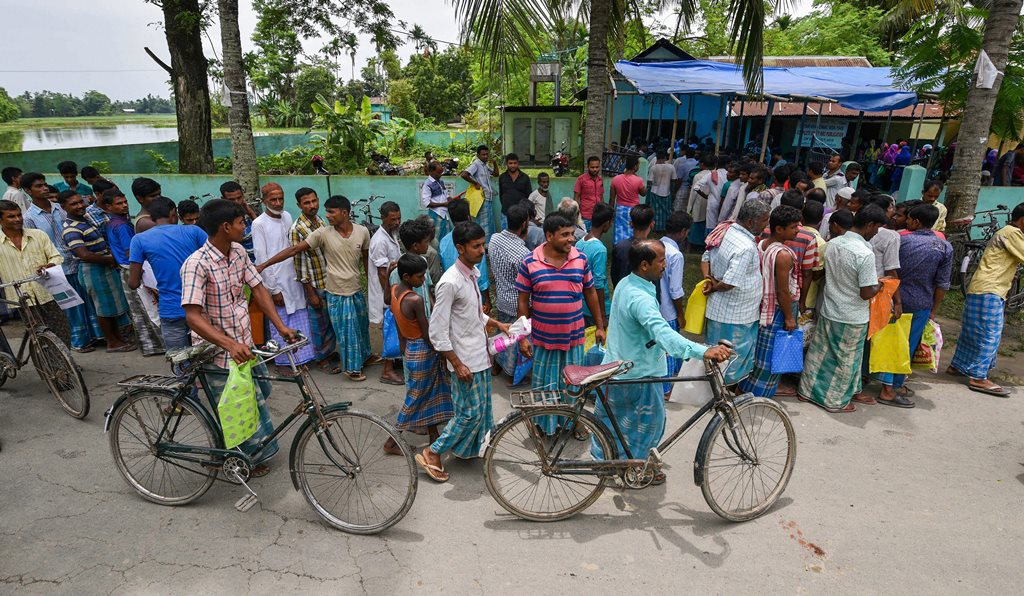 Nagaon: People wait to check their names on the final draft of the state's National Register of Citizens after it was released, at a NRC Seva Kendra in Nagaon on Monday, July 30, 2018. (PTI Photo) (PTI7_30_2018_000126B)