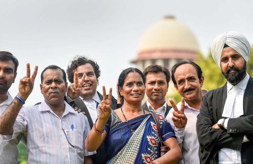 New Delhi: Nirbhaya's parents show victory sign after the Supreme Court's verdict on Dec 2012 gang rape case, in New Delhi on Monday, July 9, 2018. The apex court upheld the death sentence of the three convicts in the case. (PTI Photo/Ravi Choudhary) (PTI7_9_2018_000076B)